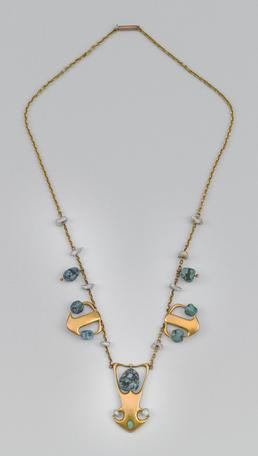 Liberty gold and turquoise necklace designed by Archibald…
