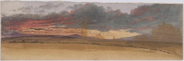 Westward view of rolling hills and red sunset