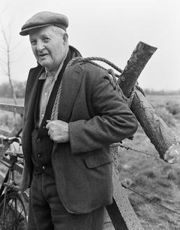 Mr Corkhill gathering wood, the Curraghs