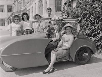 Vehicle and holidaymakers at holiday camp