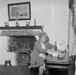 Mona Douglas book-signing in Molly Carrooin's Cottage, Onchan