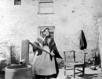 Mrs Teare at the water pump, Jurby, Isle…