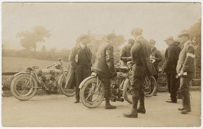 Group of TT (Tourist Trophy) riders and marshals,…