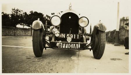 Official motorcar, registration MN5911 parked at Grandstand ('Roads…