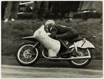 Werner Haas, riding NSU (number 7) 1954 TT…