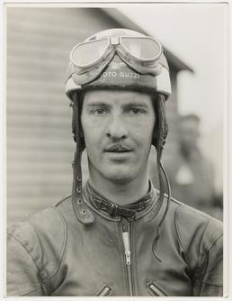 Cecil Sandford, wearing Moto Guzzi helmet and goggles,…