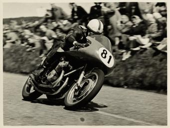 John Surtees, riding as number 81, 1956 TT…