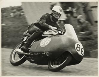John Hartle, riding a Norton (number 86), 1957…