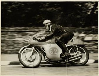 John Surtees, riding as number 62, 1958 Junior…