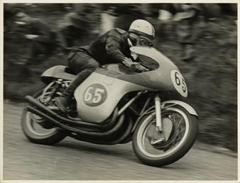 John Surtees, riding MV Agusta (number 65), 1958…