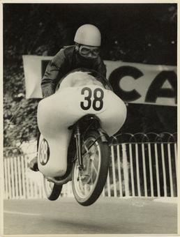 Tansharu Noguchi aboard 124cc Yamaha (number 38), 1961…