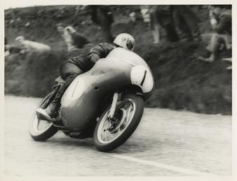 Bob McIntyre, TT (Tourist Trophy) rider, riding 499cc…