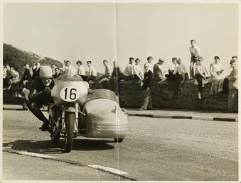 Eric Oliver, driving sidecar outift (number 16), 1958…