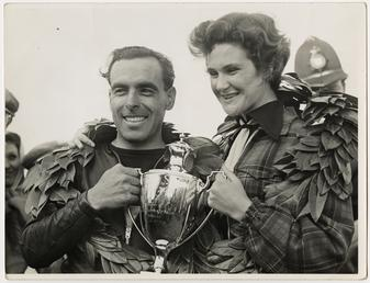 Sidercar TT (Tourist Trophy) crew holding a silver…