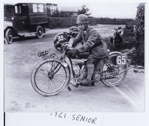 Freddie Dixon aboard an Indian motorcycle number 65…