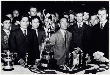 Group standing behind TT (Tourist Trophy) trophy, 1963
