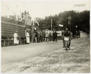 E.Williams, the winner of the Junior TT, finishes…