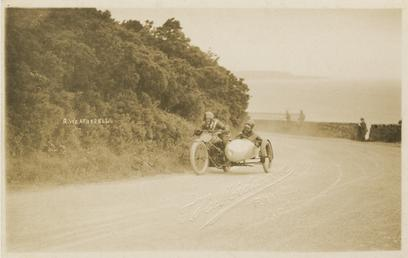 R. Weatherell aboard sidecar outfit number 58, 1920s…