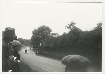 TT (Tourist Trophy) riders approaching camera, possibly St…