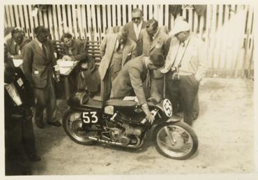 Reg Armstrong pushing Gilera number 53 away from…