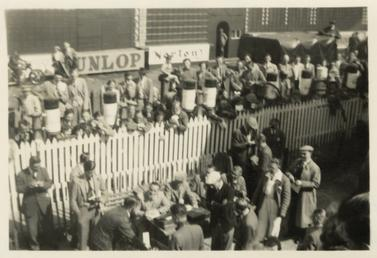 Crowd watching weigh in at Grandstand, 1954 TT…
