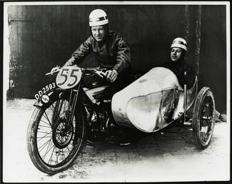 F.W. Dixon aboard Douglas sidecar outfit number 55,…