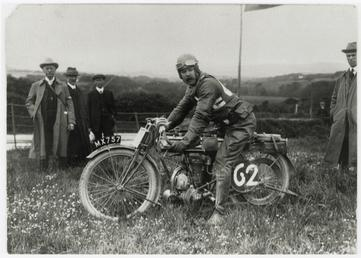 Rider number 62 poses aboard machine registration MX757,…