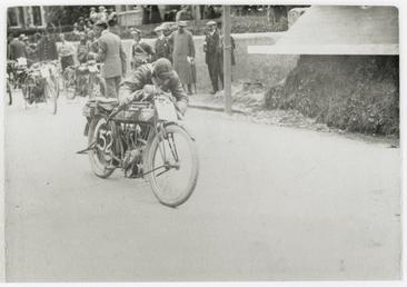 TT (Tourist Trophy) rider Frank Bateman push starting…