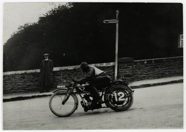 Rider number 12 (riding machine registration BB805) passes…