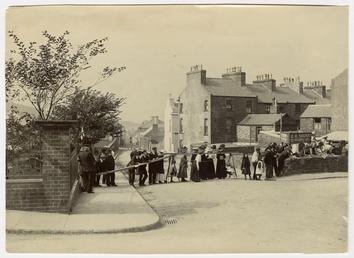 Spectators awaiting racers at Derby Road, Peel, Motorcycle…