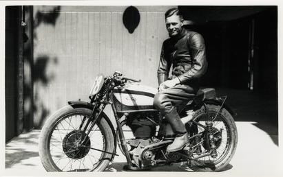 Freddie Frith poses aboard Norton number 18, 1939…