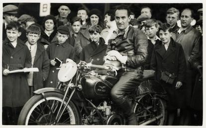 Stanley Woods poses aboard a Moto Guzzi machine,…