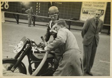 Albert Moule aboard Norton number 52 refuelling at…