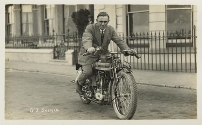 G.J. Sheman poses aboard Triumph registration MN1527, 1921…
