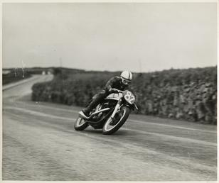 John Surtees aboard machine number 82 on the…