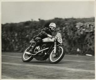 L.R. King aboard Norton number 33, on the…