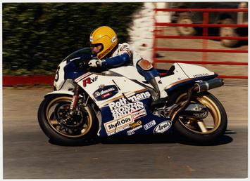 Joey Dunlop aboard Rothmans Honda number 3 rounds…