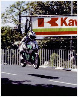 Robert Dunlop at Ballaugh Bridge aboard machine number…