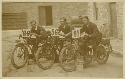 TT (Tourist Trophy) riders pose aboard their machines,…