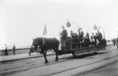 Open-top horse tram No.24 full of passengers on…