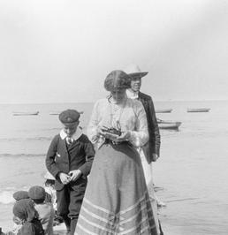 Small group, possibly a family, on Douglas shore