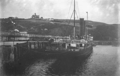 Vessel berthed in Douglas outer harbour with Douglas…