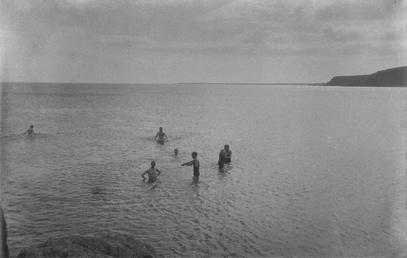 Group of men bathing in the sea, [Port…