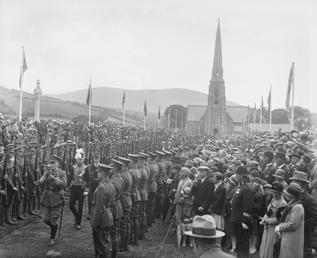 Spectators viewing procession approaching Tynwald Hill during Tynwald…