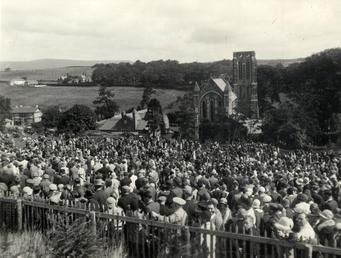 Congregation attending outdoor Sunday Service Kirk Braddan