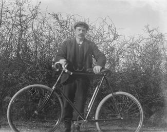 George Wade with his bicycle, Isle of Man