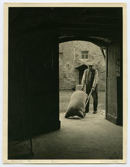 Mr Faragher, the miller at Castletown, at work