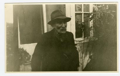 Mr Goldsmith outside his cottage