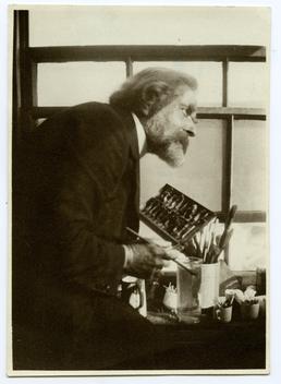Archibald Knox in his studio