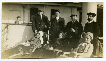 Boat passengers, including Archibald Knox